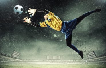Goalie reaching for soccer ball